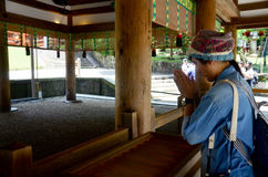 Thai women pray and donation at Kasuga Shrine Stock Image