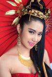 Thai women with red umbrella. Thai woman with red umbrella - studio shot Royalty Free Stock Photo