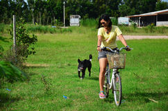 Thai women riding bicycle in the garden Stock Image
