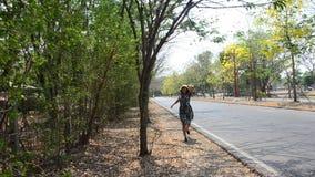 Thai women running beside road stock video