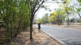Thai women running beside road stock video footage