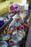 Thai women selling fruits on floating market Stock Images