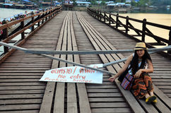 Thai women sitting on Broken Mon Bridge in Sangkhl Stock Photo