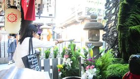 Thai women splash water with Fudomyoo statue stock video footage