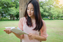 Thai women stand reading book or magazine With happy emotions un stock photography