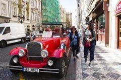 Thai women take photo with red retro car at old town near Charles Bridge Stock Photos