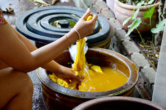 Thai women tie batik dyeing yellow natural color made from turme Royalty Free Stock Photography