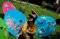 Thai women travel and portrait with Handmade Art Umbrella at Bo- Stock Photography