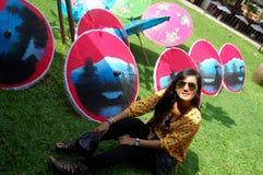 Thai women travel and portrait with Handmade Art Umbrella at Bo- Stock Photo