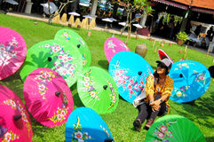 Thai women travel and portriat with Handmade Art Umbrella at Bo-. Thai woman travel and portriat with Handmade Art Umbrella for show and sale traveler at Bo-sang Royalty Free Stock Image