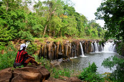 Thai women travel and posing for portrait at Tad Pha Suam waterfall Stock Photography