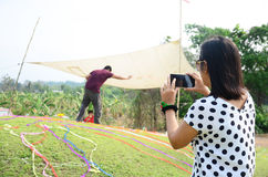 Thai women use mobile phone take photo Ceremony. Qingming Festival is when Chinese people visit the columbarium, graves or burial grounds to pray to their stock images