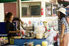 Thai women vendor made smoothie fruits and sale drink beverage w Stock Photography