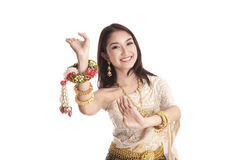 Thai women welcome with traditional Thai suit in studio. Thai woman welcome with traditional Thai suit in studio on white background Stock Photography