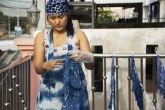 Thai women working Indigenous knowledge of thailand tie batik dyeing indigo color at outdoor on top of house at Thailand. Thai woman working Indigenous knowledge stock photos