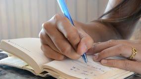 Thai women write memory on book. stock video footage