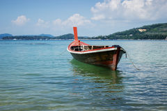 Thai wooden boat on a calm sea Stock Images