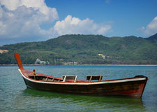Thai wooden boat on a calm sea bay Stock Photography