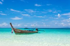 Thai wooden boat on the coast of the Andaman Sea. Boat trip in this typical long tail boat. royalty free stock image