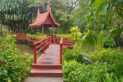 Thai wooden bridge with luxury garden Royalty Free Stock Photos