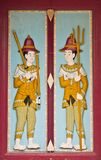 Thai wooden carving door guardian pattern Stock Photos