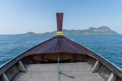 Thai wooden head longtail boat heads toward Stock Image