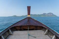 Thai wooden head longtail boat heads toward Stock Image