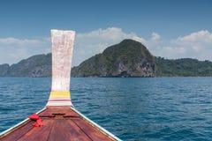 Thai wooden head longtail boat heads toward Royalty Free Stock Photos