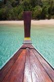 Thai wooden head longtail boat heads toward Royalty Free Stock Photography