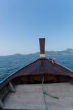 Thai wooden head longtail boat heads toward Royalty Free Stock Image
