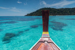 Thai wooden head longtail boat heads toward Royalty Free Stock Images