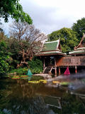 Thai wooden house. By the pond Royalty Free Stock Images