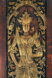 Thai Wooden Sculpture Male Angle. On Temple Door Stock Photography