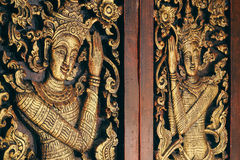 Thai Wooden Sculpture Male Angle. On Temple Door Royalty Free Stock Photos
