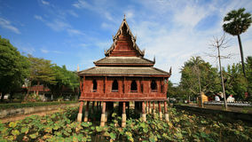 Thai wooden temple architecture on the lotus pond Royalty Free Stock Image