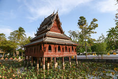 Thai wooden temple architecture on the lotus pond at wat Thung S Stock Photography