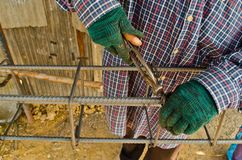 Thai worker infix iron grid by pliers Royalty Free Stock Photos