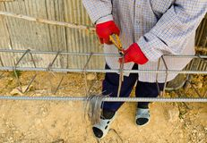 Thai worker infix iron grid by pliers Stock Images