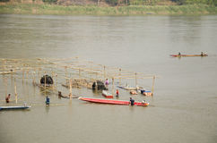 Thai worker people demolition wood structure of floating restaurant in Mekong river because flood. At Kaeng Khut Khu in Chiang Khan on February 21, 2017 in Loei stock image