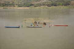 Thai worker people demolition wood structure of floating restaurant in Mekong river because flood. At Kaeng Khut Khu in Chiang Khan on February 21, 2017 in Loei royalty free stock photography