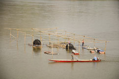 Thai worker people demolition wood structure of floating restaurant in Mekong river because flood. At Kaeng Khut Khu in Chiang Khan on February 21, 2017 in Loei royalty free stock images
