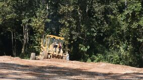 Thai workers use heavy machinery made and build road at Doi Tung in Chiang Rai, Thailand stock footage