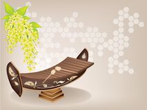Thai Xylophone and Cassia Fistula Flower on Brown. Music Instrument, An Illustration of A Vintage Thai Alto Xylophone and Yellow Color of Cassia Fistula or Stock Images