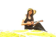 Thai young girl with Ukulele in mound. Royalty Free Stock Image