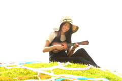 Thai young girl with Ukulele in mound. Stock Photos