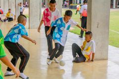 Thai young student playing football together at their school in Bangkok, Thailand September 9 , 2016 royalty free stock photo