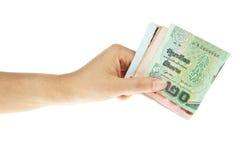 Thaibaht Banknoten mit der Hand stockfotografie