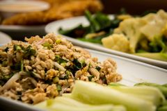 Thaifood. Spicy minced pork with herb asian chef clean close up cook cooking cuisine delicious diet dining table dinner dish diversity eat favorite fresh green stock photography