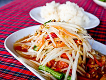 Thaifood, spicy papaya salad called Somtum 1. Spicy papaya salad or Somtum in Thai with sticky rice Stock Images
