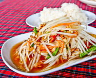 Thaifood, spicy papaya salad called Somtum 2. Spicy papaya salad or Somtum in Thai with sticky rice Stock Photos
